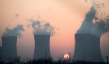 This photo taken on December 22, 2014 shows smoke rising in the air from a power plant near Hengshui in China's Hebei province. China has for years been hit by heavy air pollution, caused by enormous use of coal to generate electricity to power a booming economy, and by more vehicles on the roads. China said in November that it aims to cap its annual coal use at 4.2 billion tonnes by 2020, a one-sixth increase on current consumption, already by far the world's largest.     AFP PHOTO / FRED DUFOUR        (Photo credit should read FRED DUFOUR/AFP/Getty Images)
