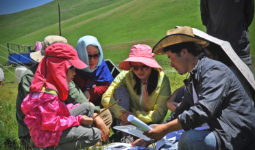 As part of his village's ecotourism initiative, village leader Donchi teaches visitors from the cities about the grasslands and his community's way of life. (Photo: Pacific Environment)