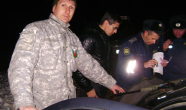 Eugene Stoma with police apprehending a poacher. (Photo: Pacific Environment)